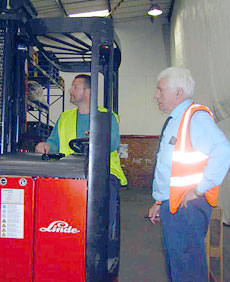 Picture of a man under instruction operating a fork lift
