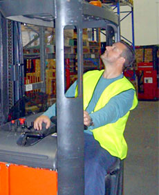 Picture of a man operating a fork lift